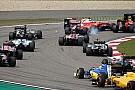 Clima esquenta entre Vettel e Kvyat antes do pódio
