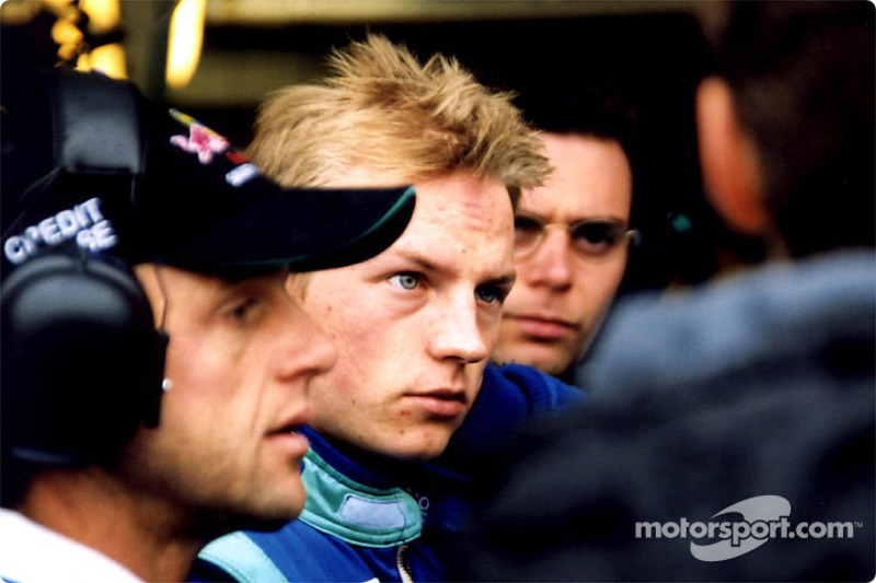 Kimi Raikonnen with his team