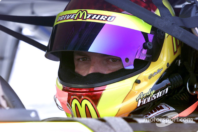 Andy Houston sits in his car waiting to practice for Saturdays race under the lights