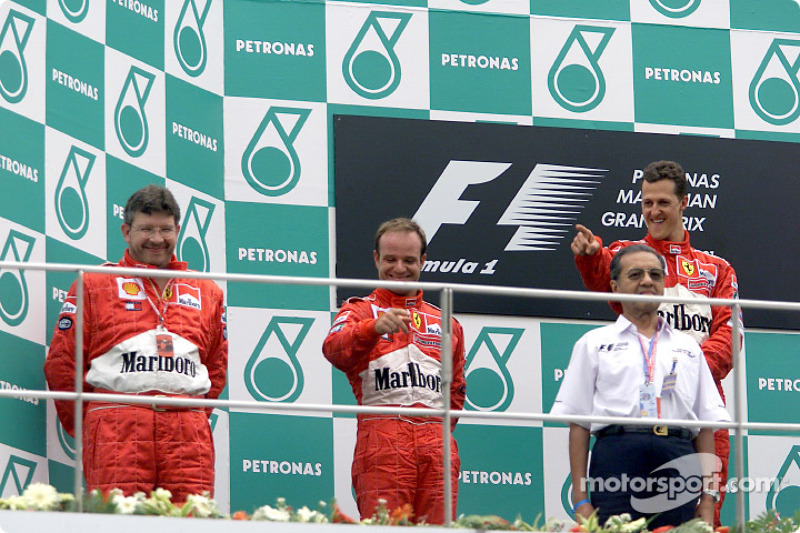 Ross Brawn, Rubens Barrichello and Michael Schumacher on the podium