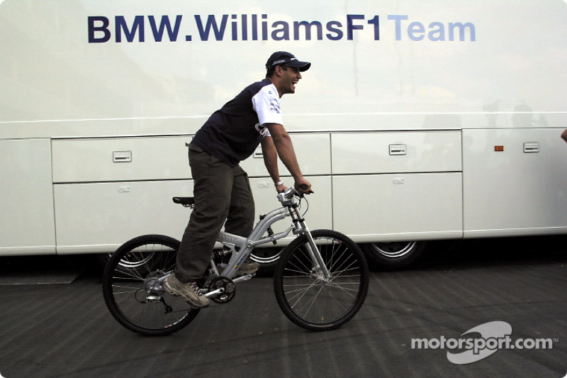 Juan Pablo Montoya and his new toy: a BMW mountain bike