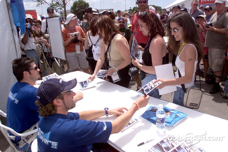 Alex Tagliani and Patrick Carpentier signing autographs