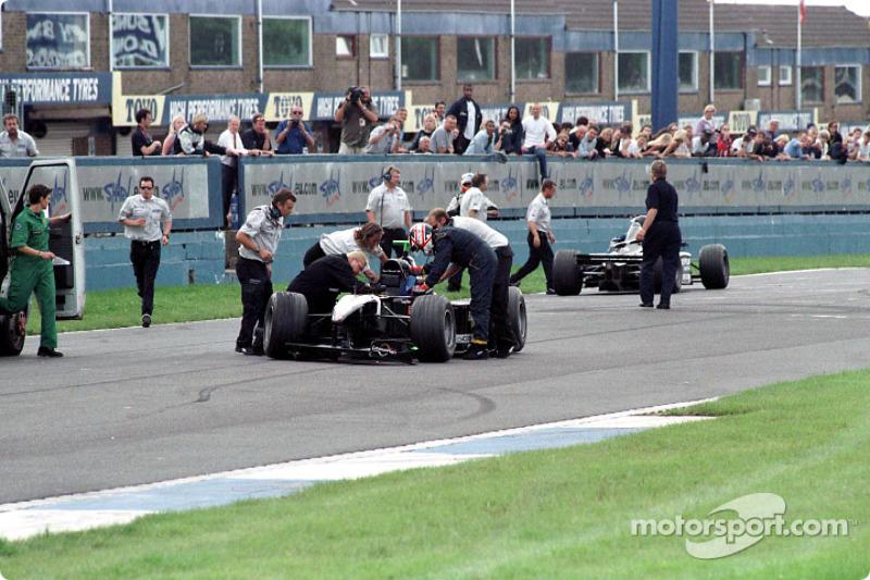 Nigel Mansell checking his passenger