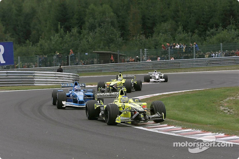 Jean Alesi in front of Jenson Button
