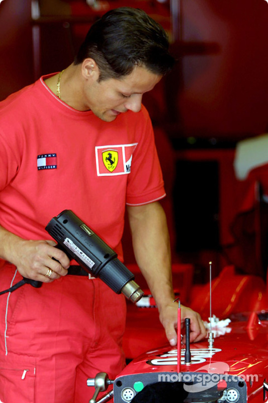 Team Ferrari crew taking the sponsors logos off the car, Ferraris will race with no logos at Monza t