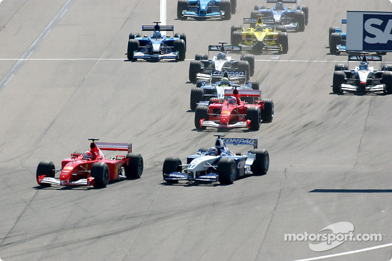 First corner: Michael Schumacher taking the lead in front of Juan Pablo Montoya