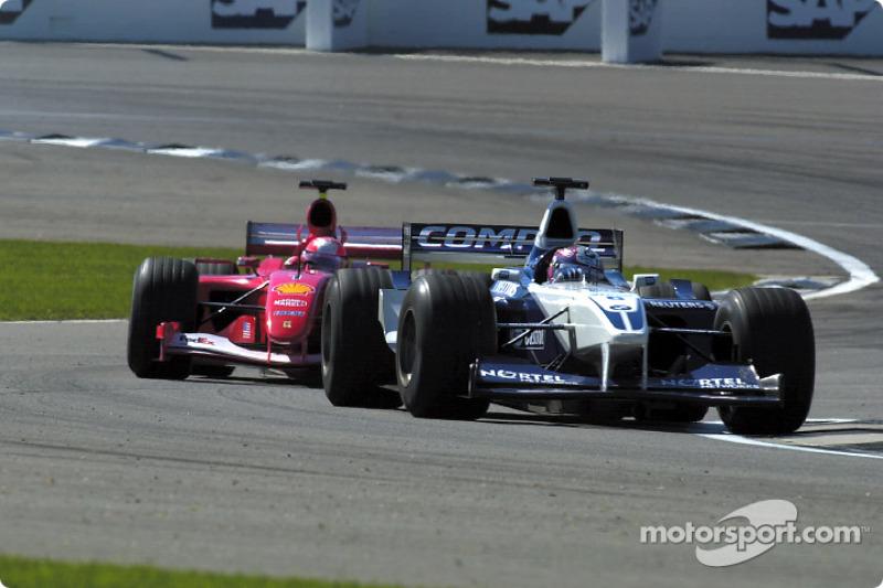 Juan Pablo Montoya passing Michael Schumacher