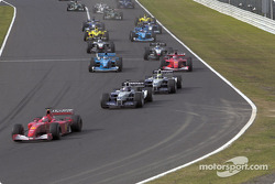 First corner: Michael Schumacher in front of Juan Pablo Montoya and Ralf Schumacher
