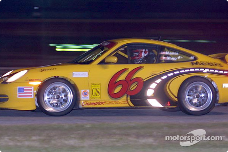 The #66 SpeedSource Porsche races through the darkness during Grand-Am Cup night practice at Daytona International Speedway