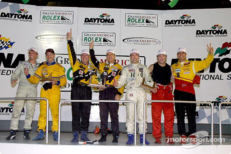 The overall podium finishers celebrate in Victory Lane after the Grand-Am Cup finale