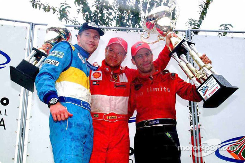 The podium: race winners Mario Haberfeld, Rubens Barrichello and Tony Kanaan