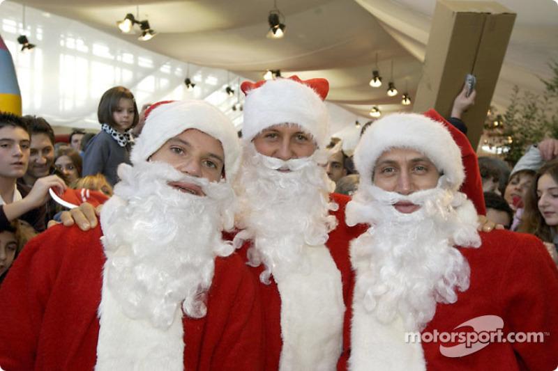 Le traditionnel Noël de Ferrari : Rubens Barrichello, Michael Schumacher et Luca Badoer