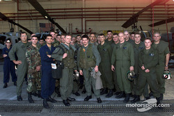 Patrick Carpentier poses with Captain Aaron Marx and the ground crew of the Stingers squadron after taking part in a training mission aboard a AH-1W Cobra helicopter