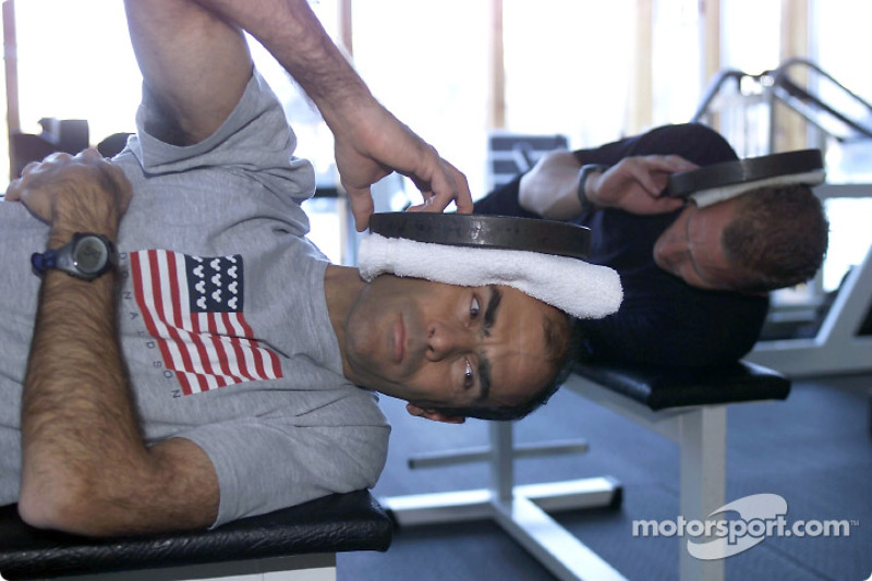 Hold your head up high: Emanuele Pirro (front) and Johnny Herbert working out with weights; in a training specifically for race drivers the focus was on strengthening shoulder and neck muscles