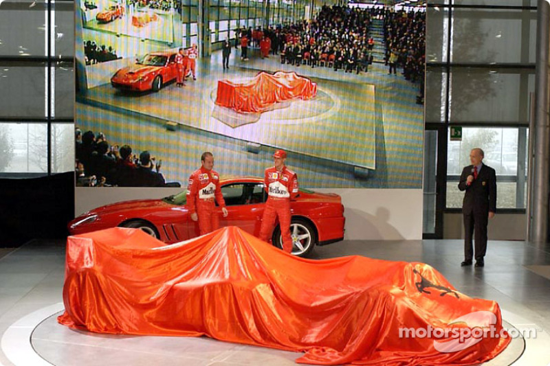 Rubens Barrichello and Michael Schumacher about to unveil the new Ferrari F2002