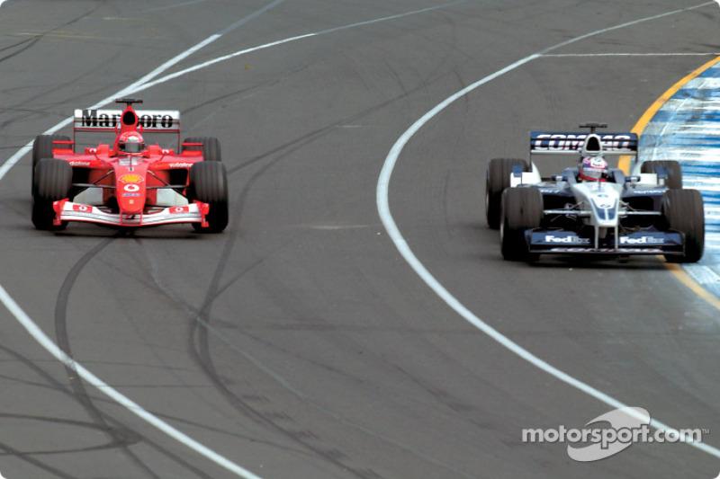 Michael Schumacher passing Juan Pablo Montoya