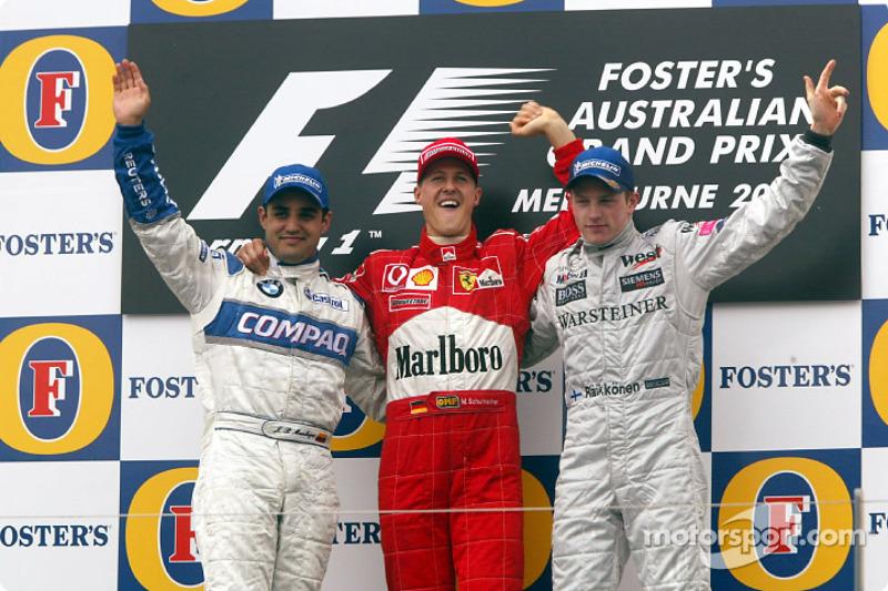 Le podium : le vainqueur Michael Schumacher, avec Juan Pablo Montoya et Kimi Räikkönen
