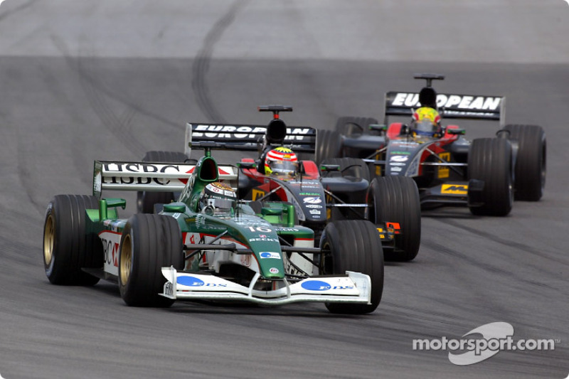 Eddie Irvine battling with Alex Yoong and Mark Webber