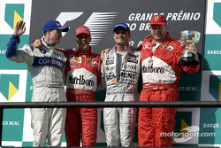 The podium: race winner Michael Schumacher with Ralf Schumacher, David Coulthard and Ross Brawn
