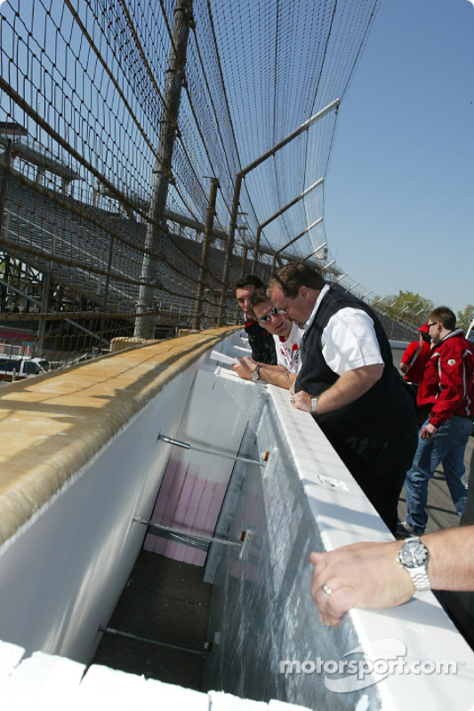 Drivers and race officials examining the new SAFER wall