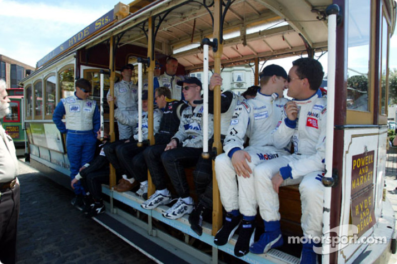 Drivers from the American Le Mans Series touring San Francisco aboard a cable car
