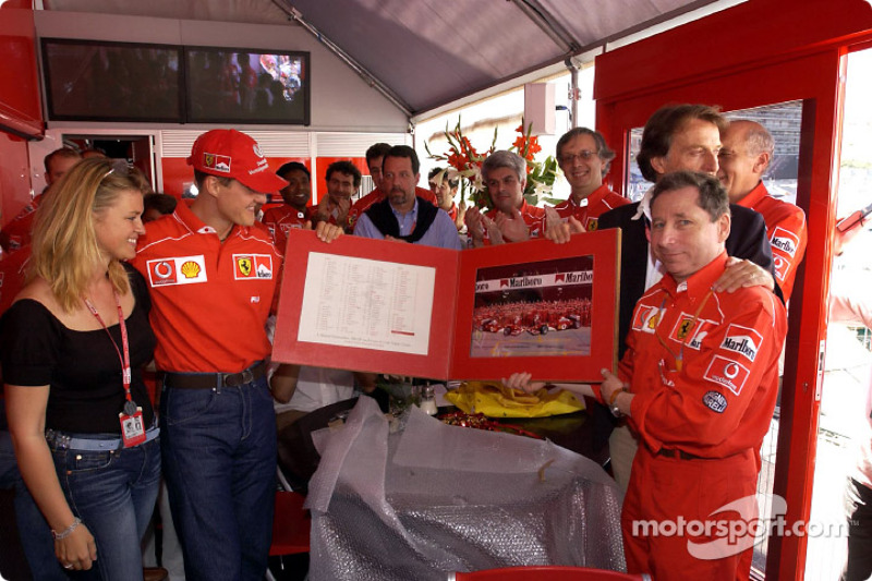 Michael Schumacher celebrating his 100th Grand Prix with Ferrari