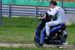 Jean Alesi hitching a ride back to the pits