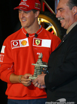Bridgestone Motorsport / Scuderia Ferrari press conference: Michael Schumacher receiving an Inuit sculpture from Robert Vetter of Brigdestone Canada