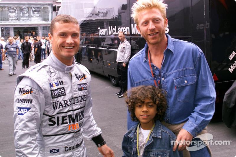 Boris Becker and his son Noah visiting David Coulthard and the McLaren Mercedes team