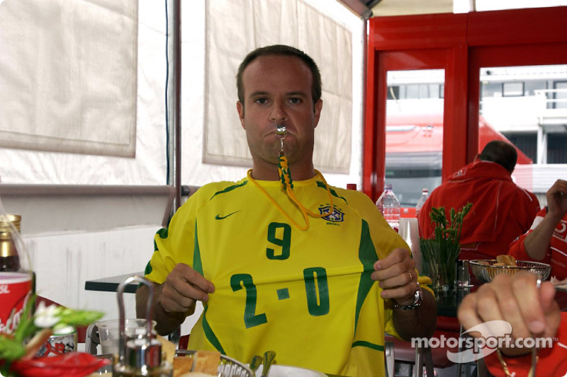 Rubens Barrichello celebrating Brazil's victory at the World Cup