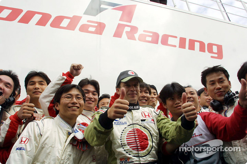 Olivier Panis celebrating with Honda crew members