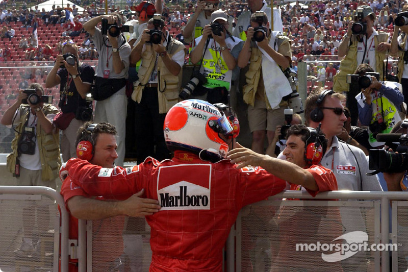 Pole winner Rubens Barrichello celebrating