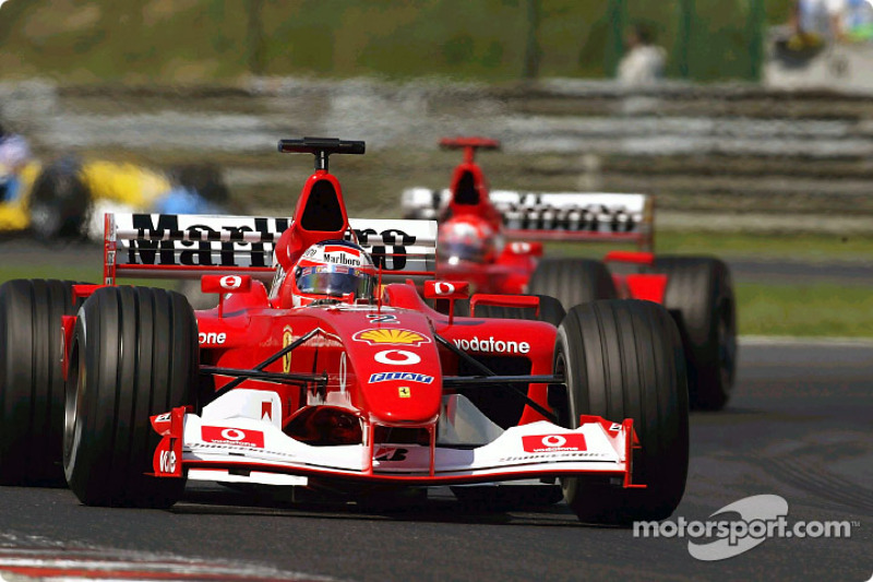Rubens Barrichello frente a Michael Schumacher