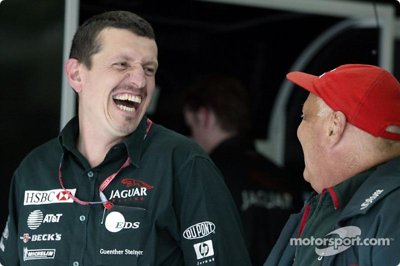 Team Managing Director Guenther Steiner enjoying a joke with Jaguar Racing Team Principal Niki Lauda