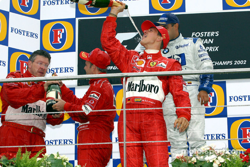 The podium: champagne for Michael Schumacher, Rubens Barrichello, Juan Pablo Montoya and Ross Brawn