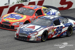 Rusty Wallace racing side by side with Dale Jarrett
