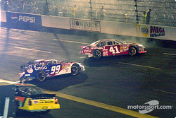 Jeff Burton and Jimmy Spencer litter the track