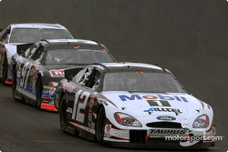 Ryan Newman leads Kurt Busch