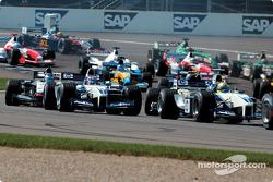 First corner: Juan Pablo Montoya and Ralf Schumacher
