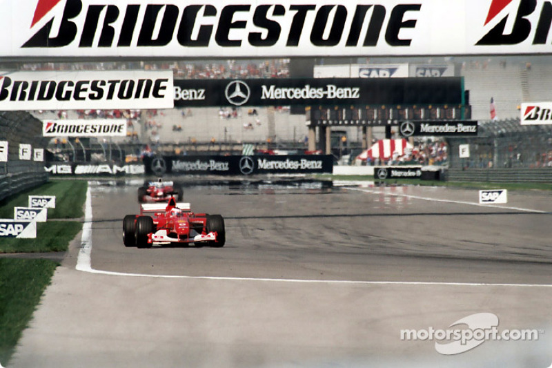 Michael Schumacher leads down the infield straight