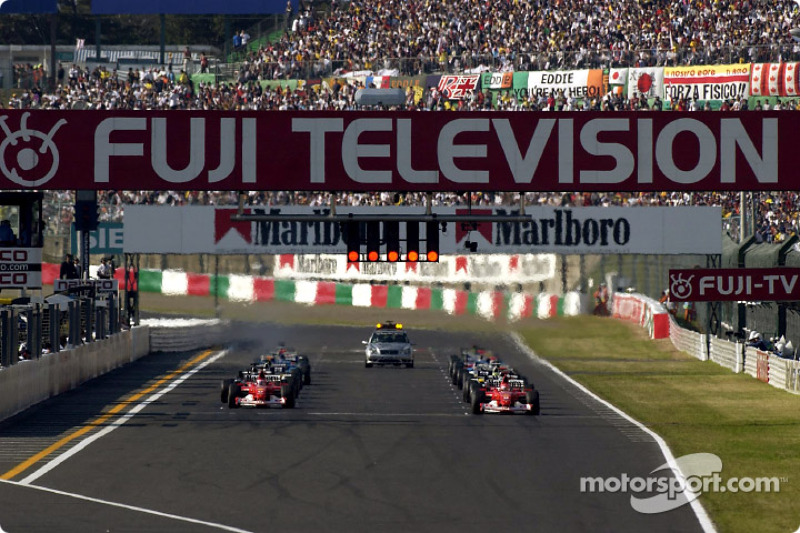 Michael Schumacher and Rubens Barrichello wait for green light
