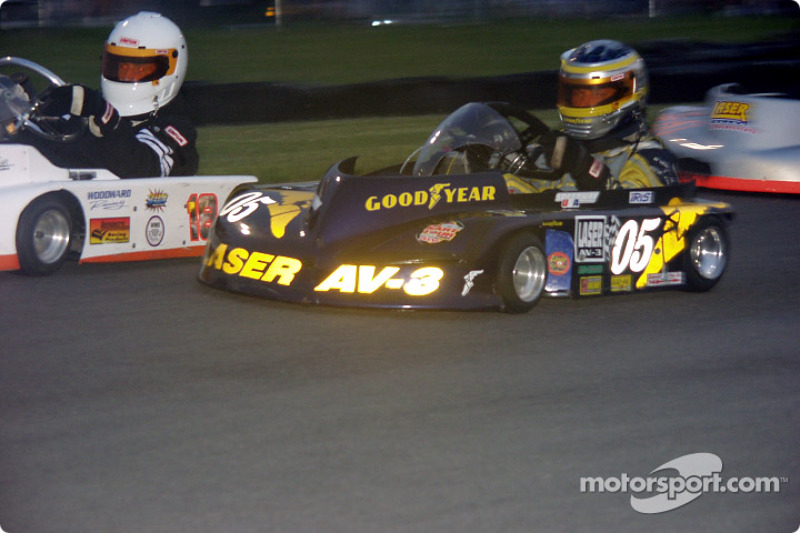 #05-Kerry Parnell gets by the #18-John Woodward, Jr. during the Animal 250 Pro Kart Tour race at Chapel Hill Raceway in Humphrey, NY