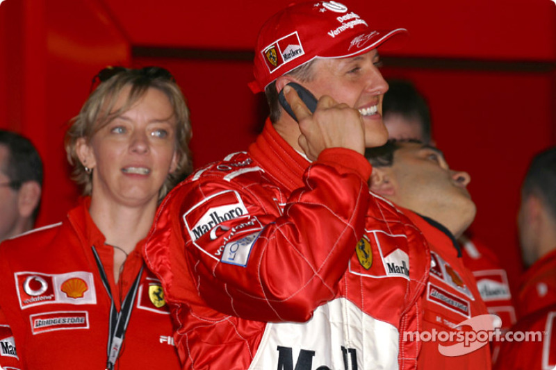 Michael Schumacher celebrates his pole position