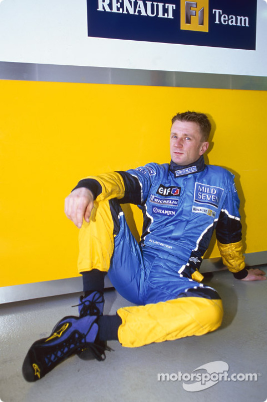 Allan McNish waits for Friday morning testing session