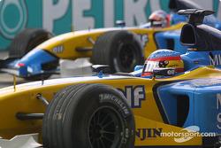 Pole winner Fernando Alonso leads the field to the warmup lap