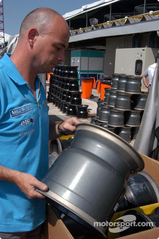 Renault F1 team member prepares the wheels