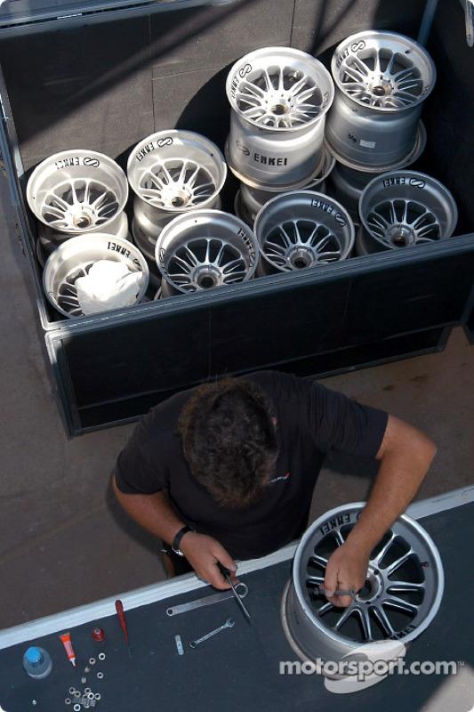 McLaren team member prepares the wheels