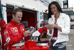 Rubens Barrichello and supermodel Megan Gale exchange phone numbers