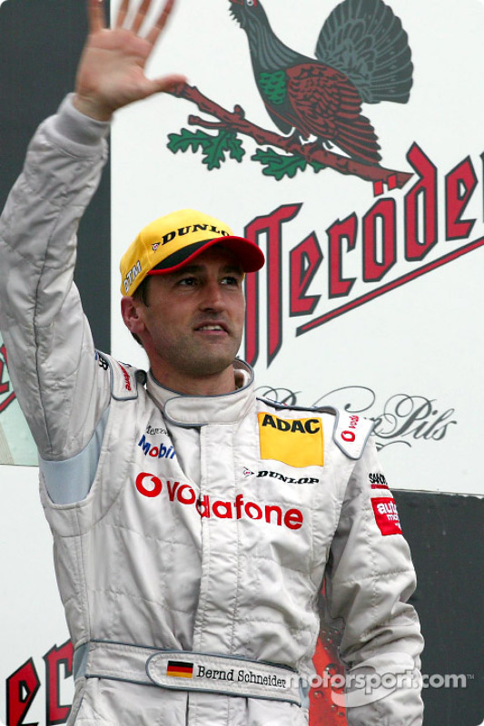 The podium: race winner Bernd Schneider