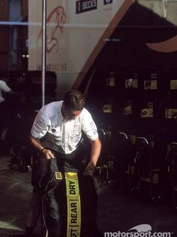 Jaguar team member prepares the tires